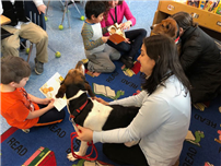 First Grade Students Reading To Dogs photo thumbnail87241
